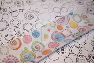 Trace an image onto some vellum paper and then colour your image.