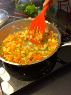 Sautéing the vegetables for the rice dish
